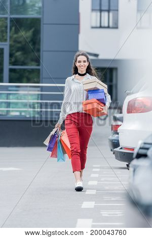 Happy Woman With Shopping Bags And Boxes On Shopping
