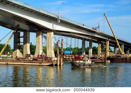 Picturesque view of river bridge under construction