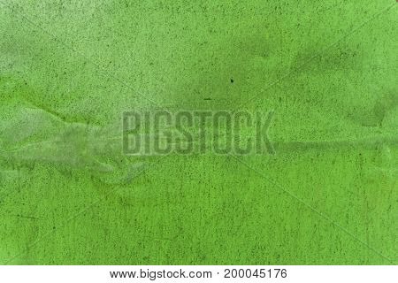 Green painted aluminum sheet background with wrinkled