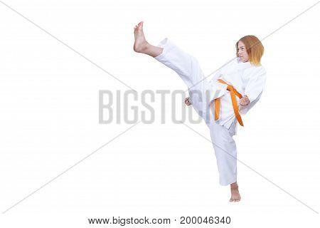 Adult girl athlete beats kicking against white background