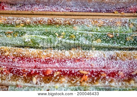 Close up colorful turkish delight bars on counter in market poster