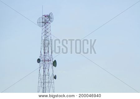 Mobile phone communication tower transmission with blue sky background and antenna