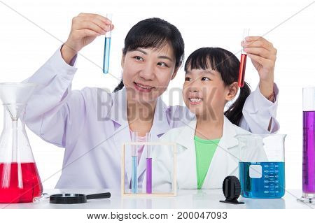 Asian Chinese Teacher And Little Student Girl Working With Test Tube