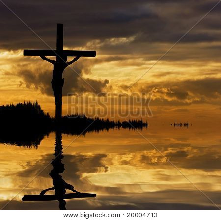 Jesus Christ Crucifixion On Good Friday Silhouette Reflected In Lake Water