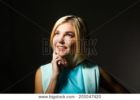 Smiling beautiful woman on empty black background