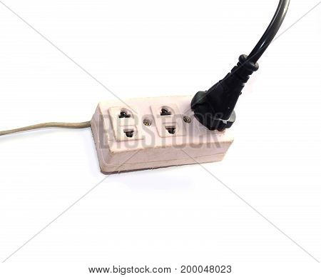 A Black Electrical  Plugged On  Pink Socketon  White Background