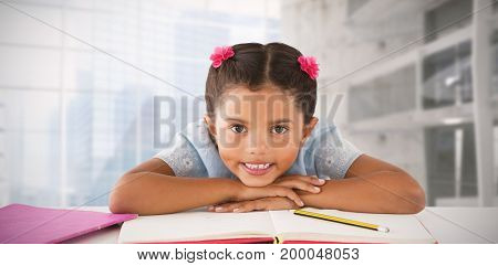 Girl clenching teeth while leaning on book against modern room overlooking city