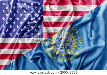 Ruffled waving United States of America and South Dakota flag