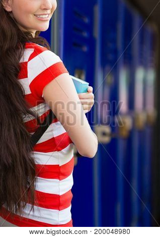 Digital composite of female student in front of lockers