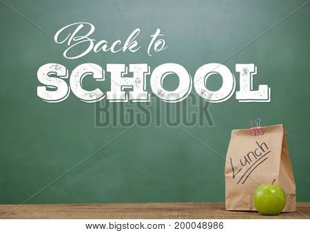 Digital composite of Lunch on Desk foreground with blackboard graphics of Back to school