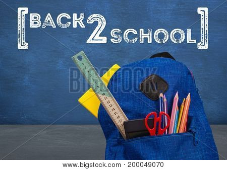 Digital composite of Schoolbag in foreground with blackboard graphics of back 2 school