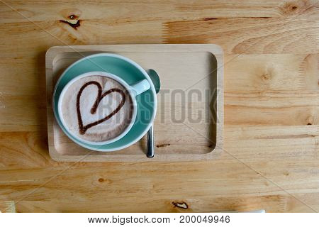 A Cup Of Coffee  With Wood Plate  On  Wooden Table