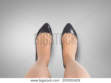 Digital composite of Black shoes on feet Blue shoes on feet with grey background