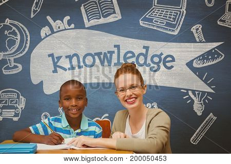 Digital composite of Happy student boy and teacher at table against blue blackboard with knowledge text and education and