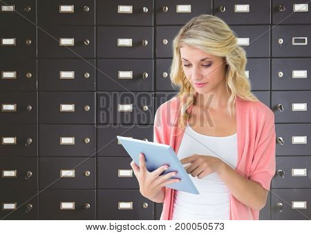 Digital composite of female student holding tablet in front of lockers