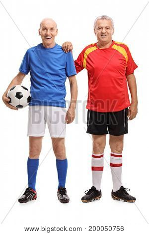 Full length portrait of two elderly soccer players isolated on white background