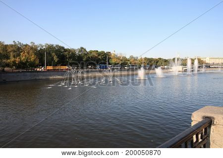 image of many fountains on river at day