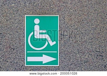 Disabled symbol On the green Stick to the marble walls.
