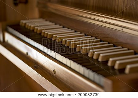 Old Church organ with wooden brown and black keys