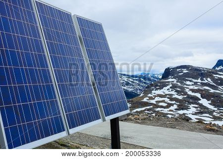 Renewable regenerative power and eco energy. Photovoltaic solar panel outdoor in norwegian mountains nature. System of electricity generation.