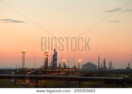 Industrial plant in the evening against the sunset