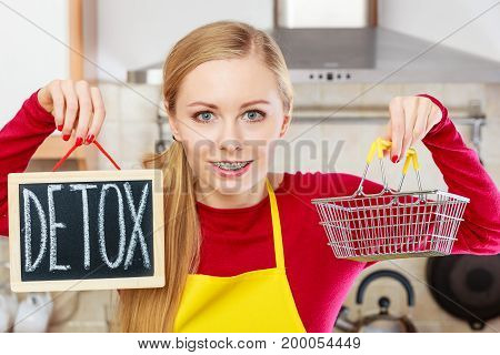 Happy Woman Holding Detox Sign And Shopping Basket