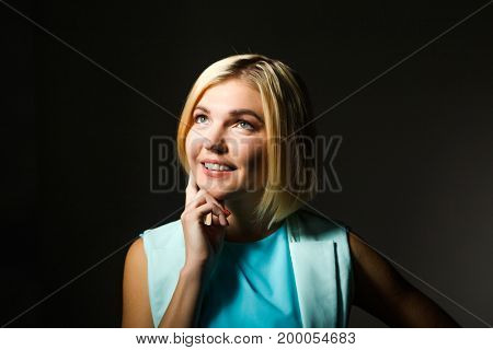 Woman on empty black background