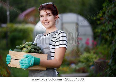 Young brunette with cucumber crop