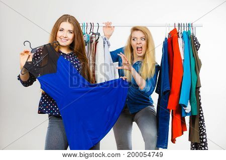 Woman Picking Clothes In Wardrobe, Friend Being Jealous
