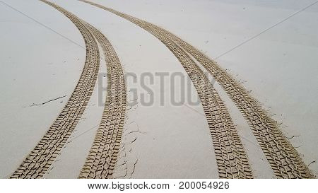 a Tire tracks on the sand background