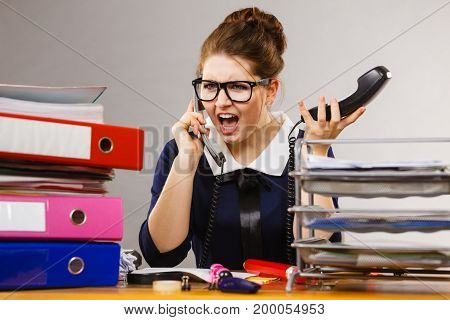 Shocked Business Woman Talking On Phone