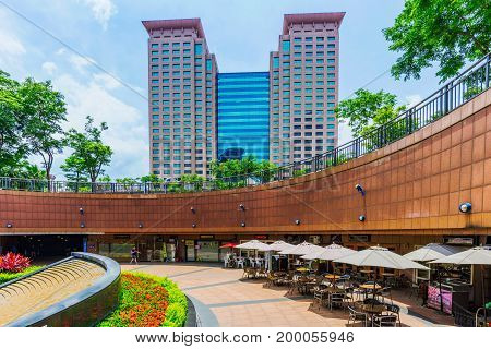 TAIPEI TAIWAN - JUNE 24: This is the exterior architecture of Banqiao station in the New Taipei area with an outdoor cafe on June 24 2017 in Taipei