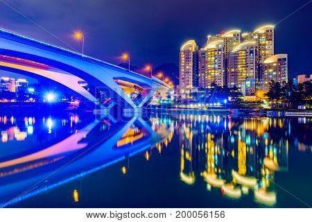 Riverside night view of bridge and architecture