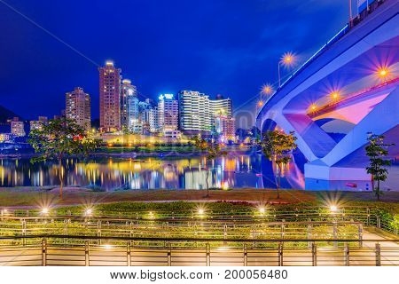 TAIPEI TAIWAN - JUNE 22: This is a night view of Bitan riverside park in the Xindian district. The park is a popular travel destination where people go to see scenic views of the area on June 22 2017 in Taipei