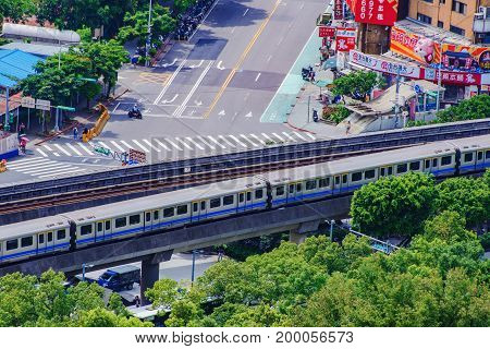 TAIPEI TAIWAN - JUNE 21: This is an aerial view of a Taipei mrt train arriving in the overground Shilin station on June 21 2017 in Taipei