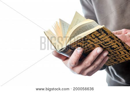 Man is browsing a book isolated on white