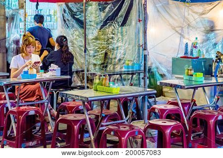 TAIPEI TAIWAN - JUNE 19: This is a night scene of a small street food vendor in the Raohe street night market. These kinds of vendors are very popular with locals on June 19 2017 in Taipei