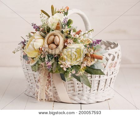 Originally decorated basket to Easter on a wooden background