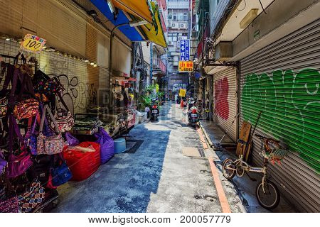 TAIPEI TAIWAN - JUNE 09: This is an old side street in the Ximen shopping and entertainment district of Taipei where many tourists and local come at night June 09 2017 in Taipei