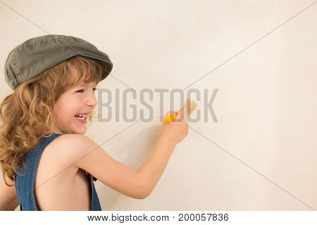 Beautiful happy chid painting wall. Renovation concept