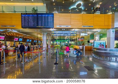 TAIPEI TAIWAN - JUNE 09: These are the check-in desks near the entrance of Songshan airport an airport close to the downtown area on June 09 2017 in Taipei