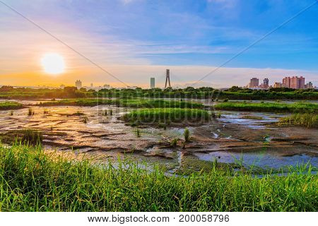 Scenic view of grassland river area in Taipei with sunset