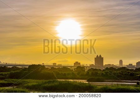 Riverside view of sunset with city buildings and nature in Taipei