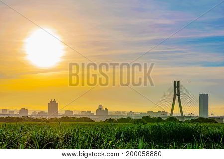 Riverside view of sunset with city buildings and nature