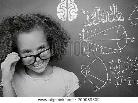 Digital composite of Girl pointing at math equations on blackboard