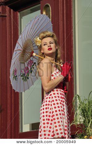 Beautiful Woman Holding An Umbrella