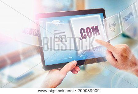 A Businesswoman Selecting A Dot Com Business Concept On A Futuristic Portable Computer Screen.