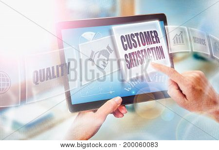 A Businesswoman Selecting A Customer Satisfaction Business Concept On A Futuristic Portable Computer