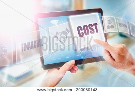 A Businesswoman Selecting A Cost Business Concept On A Futuristic Portable Computer Screen.