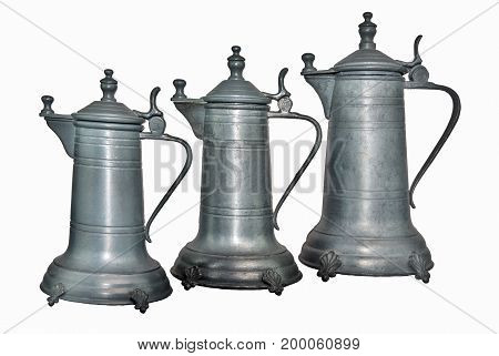 Three old Coffeepot or wine decanter of tin